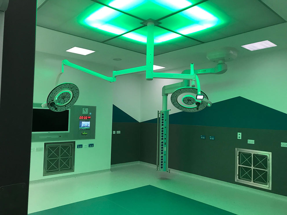 A major operating theatre upgrade at Westmorland General Hospital in Kendal, Cumbria has been completed with advanced equipment supplied, installed and commissioned by Bender UK, including LED operating lights, touchscreen theatre control panels with integrated PACS 4K viewing screen, and Contempo clinical pendants.  The refurbished theatre benefits from new medical IT power systems and uninterruptible power supplies (UPS) to provide ultra-safe and resilient power for the Group 2 critical care area, which were also provided by Bender UK. The power provision includes Bender's unique ATICS changeover solution purpose designed for medical applications with patient safety at the very core of its development.  The ATICS design incorporates permanent self-testing across all critical components and is the only medical auto-changeover device independently certified as fully compliant with Safety Integrity Level (SIL) 2 parts 1-3.  The operating lights are part of the award-winning Q-Flow™ range from Merivaara that Bender UK exclusively distribute in the UK and the Republic of Ireland. The lights deliver best-in-class colour rendering that is vital for surgeons and theatre staff to monitor the health and well-being of patients during operations, and a hugely efficient column of daylight-quality light to illuminate deep cavities.   Theatre 2 at Westmorland General is for orthopaedic surgery and the refurbishment included a clean air canopy. The circular design of the Q-Flow™ lights optimises laminar air flow to take contaminated air away from the operating site, reducing the potential for patient infections.  Bender UK's theatre control panels are manufactured in-house to exact customer specifications, with every panel programmed and configured to the client's specific needs. Control of the theatre environment is combined into a single ergonomic fingertip-operated interface panel for lighting, temperature and humidity, ventilation and critical alarms.  Each panel incorporates